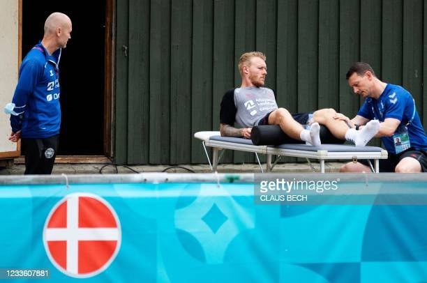 Denmark's defender Simon Kjaer receives treatment at the team's base camp in Elsinore, on June 23 during the UEFA EURO 2021 European Football...