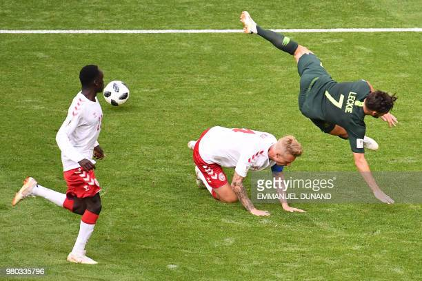 Denmark's defender Simon Kjaer vies for the ball Australia's forward Mathew Leckie during the Russia 2018 World Cup Group C football match between...