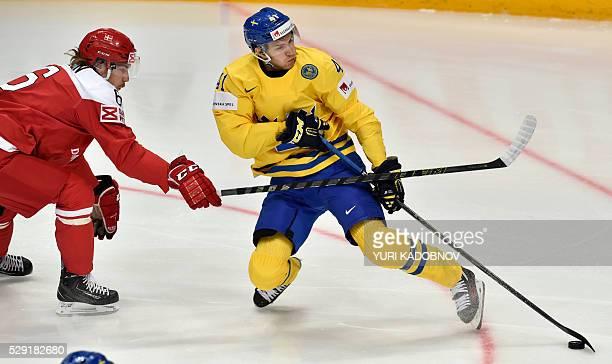 Denmark's defender Stefan Lassen vies with Sweden's forward Alexander Wennberg during the group A preliminary round game Sweden vs Denmark at the...
