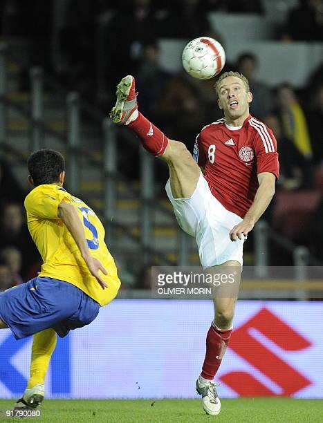 Denmark's Dennis Rommedahl struggles for the ball with Sweden's Behrang Safari during the World Cup 2010 qualifying match Denmark vs Sweden October10...