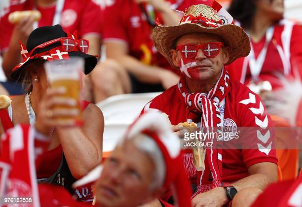 A Denmark's fan eats a sandwich as he waits for the start of the Russia 2018 World Cup Group C football match between Peru and Denmark at the...