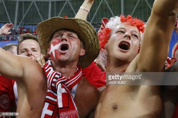 Denmark's fans celebrate at the end of the Russia 2018 World Cup Group C football match between Peru and Denmark at the Mordovia Arena in Saransk on...