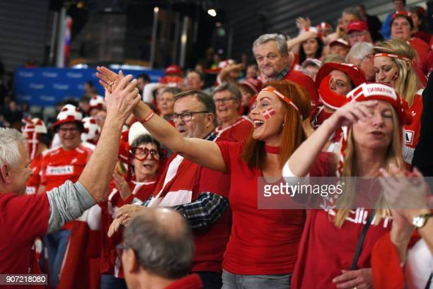 Denmark's fans celebrate their victory during the group II match of the Men's 2018 EHF European Handball Championship between Slovenia and Denmark in...