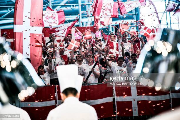 Denmark's fans wave Danish flags during the Bocuse d'Or Europe 2018 International culinary competition on June 12 2018 in Turin