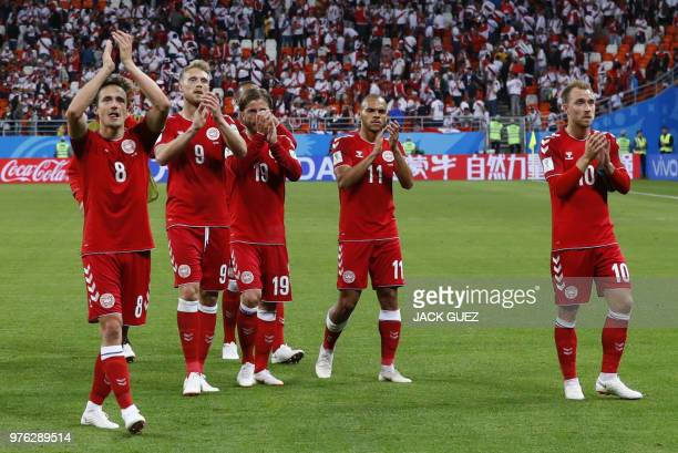 Denmark's football players applaud and celebrate after winning at the end of the Russia 2018 World Cup Group C football match between Peru and...