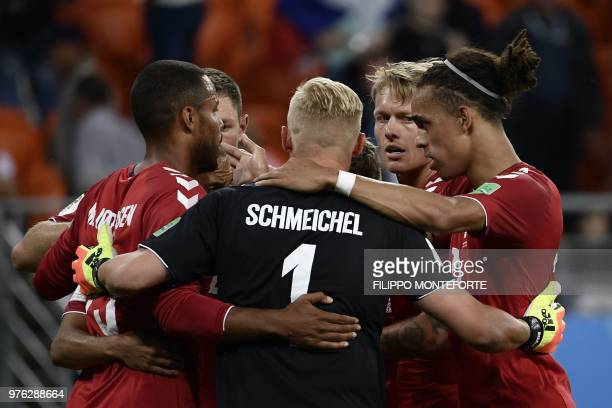 TOPSHOT Denmark's football players celebrate after winning at the end of the Russia 2018 World Cup Group C football match between Peru and Denmark at...