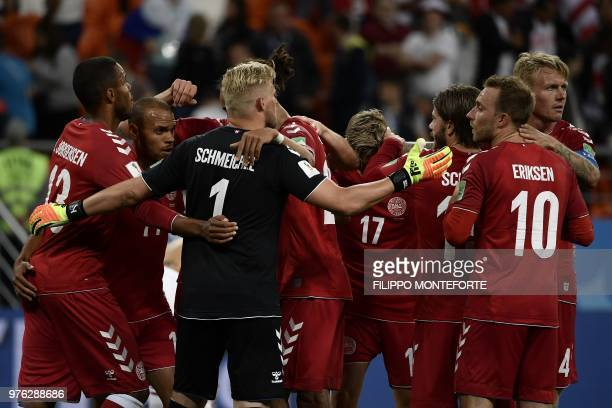 Denmark's football players celebrate after winning at the end of the Russia 2018 World Cup Group C football match between Peru and Denmark at the...