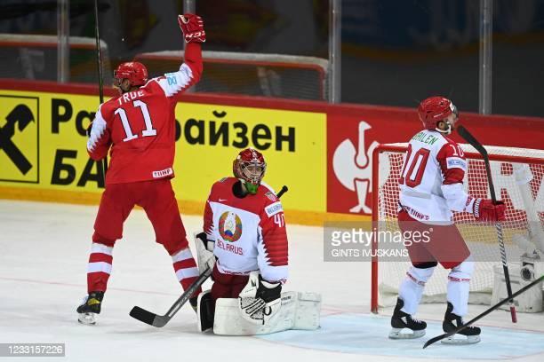 Denmark's forward Alexander True celebrates scoring the 5-2 goal next to Belarus' goalkeeper Alexei Kolosov and Belarus' defender Nick Bailen during...