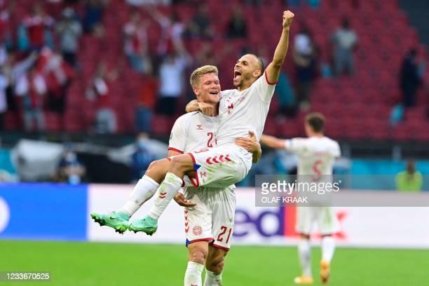 Denmark's forward Andreas Cornelius and Denmark's forward Martin Braithwaite celebrate at the end of the UEFA EURO 2020 round of 16 football match...