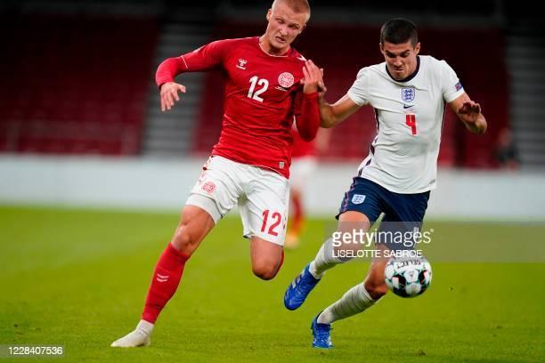 Denmark's forward Kasper Dolberg and England's midfielder Declan Rice vie for the ball during the UEFA Nations League football match between Denmark...