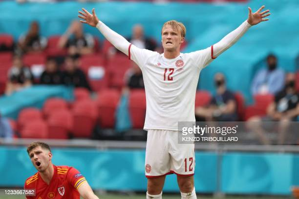 Denmark's forward Kasper Dolberg celebrates scoring their first goal during the UEFA EURO 2020 round of 16 football match between Wales and Denmark...