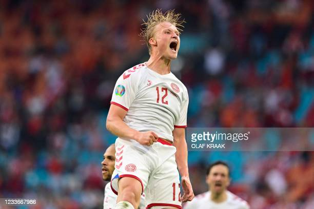 Denmark's forward Kasper Dolberg celebrates scoring their second goal during the UEFA EURO 2020 round of 16 football match between Wales and Denmark...