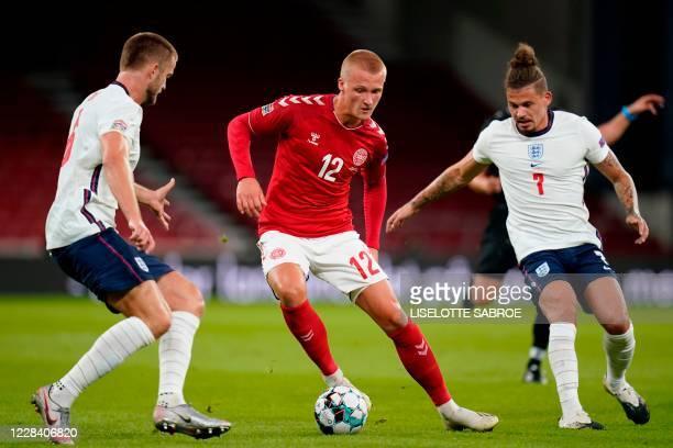 Denmark's forward Kasper Dolberg , England's midfielder Eric Dier and England's midfielder Kalvin Phillips vie for the ball during the UEFA Nations...