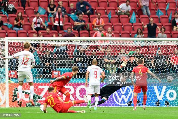 Denmark's forward Kasper Dolberg scores their first goal during the UEFA EURO 2020 round of 16 football match between Wales and Denmark at the Johan...