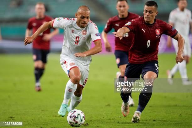 Denmark's forward Martin Braithwaite and Czech Republic's midfielder Tomas Holes fight for the ball during the UEFA EURO 2020 quarter-final football...