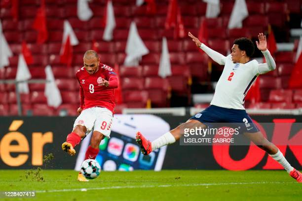 Denmark's forward Martin Braithwaite and England's defender Trent Alexander-Arnold vie for the ball during the UEFA Nations League football match...
