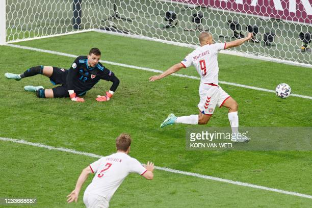 Denmark's forward Martin Braithwaite kicks and misses a goal opportunity during the UEFA EURO 2020 round of 16 football match between Wales and...