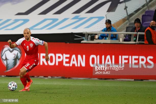 Denmark's forward Martin Braithwaite runs with the ball during the 2022 FIFA World Cup qualifier group F football match between Israel and Denmark at...