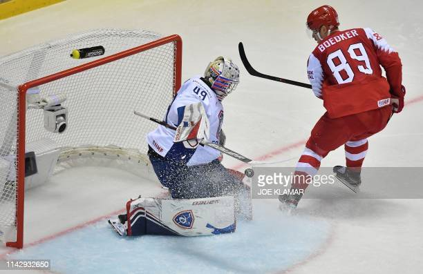Denmark's forward Mikkel Bodker fails to score past France's goalkeeper Florian Hardy during a penalty shootout at the IIHF Men's Ice Hockey World...