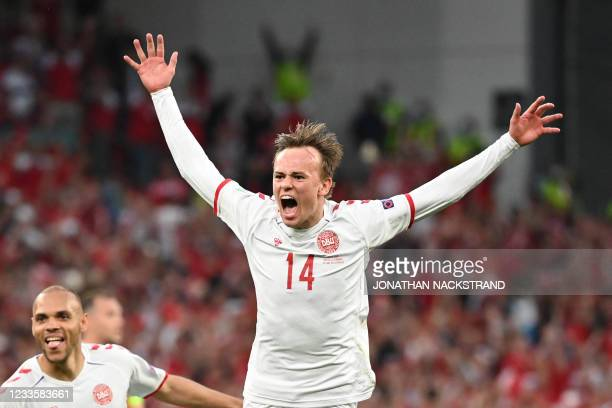 Denmark's forward Mikkel Damsgaard celebrates after scoring his team's first goal during the UEFA EURO 2020 Group B football match between Russia and...