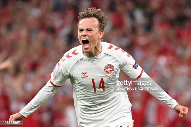 Denmark's forward Mikkel Damsgaard celebrates after scoring his team's first goalduring the UEFA EURO 2020 Group B football match between Russia and...
