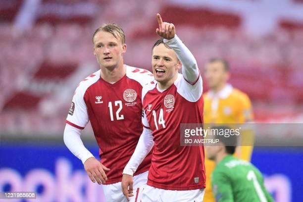 Denmark's forward Mikkel Damsgaard celebrates scoring during the FIFA World Cup Qatar 2022 qualification football match Denmark v Moldova in Herning...