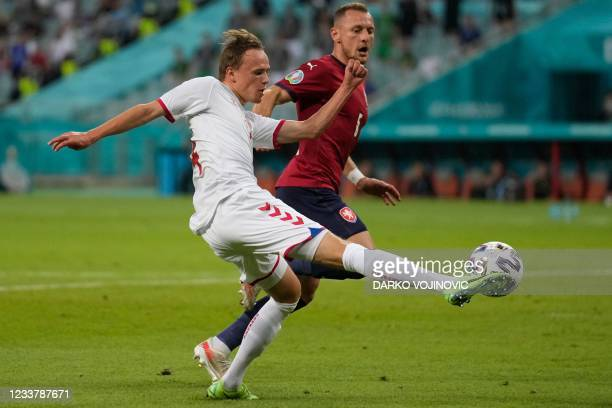 Denmark's forward Mikkel Damsgaard fights for the ball with Czech Republic's defender Vladimir Coufal during the UEFA EURO 2020 quarter-final...