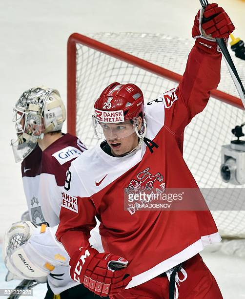 Denmark's forward Morten Madsen celebrates his team's goal during the group A preliminary round game Denmark vs Latvia at the 2016 IIHF Ice Hockey...