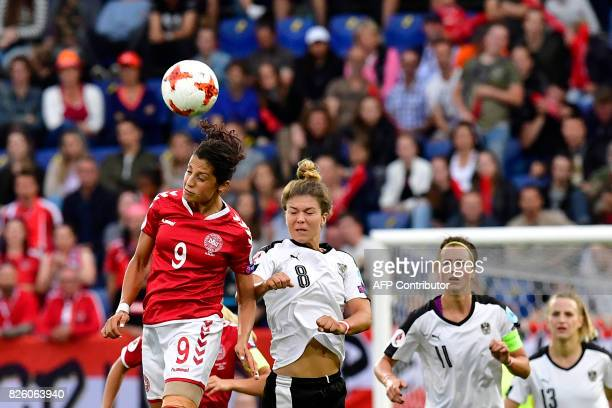 Denmark's forward Nadia Nadim and Austria's midfielder Nadine Prohaska jump for the ball during the UEFA Womens Euro 2017 football tournament...