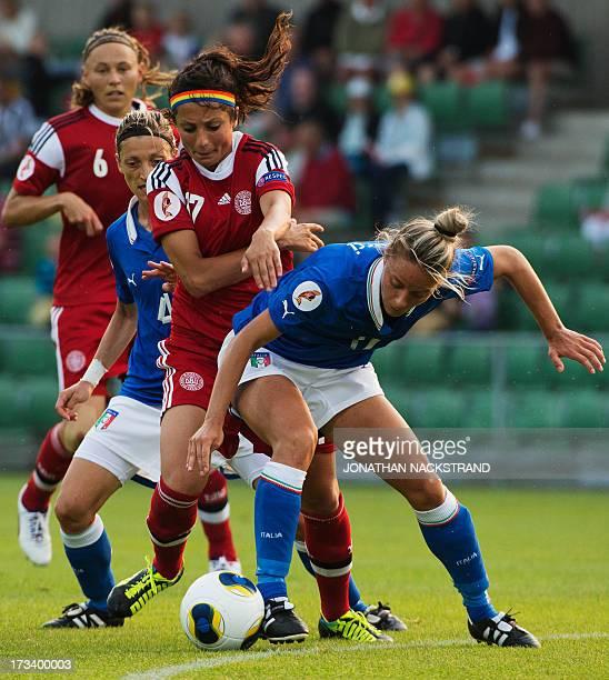 Denmark's forward Nadia Nadim and Italy's midfielder Martina Rosucci vie for the ball during the UEFA Women's European Championship Euro 2013 group A...