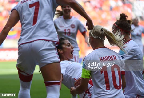 Denmark's forward Nadia Nadim celebrates with teammates after scoring a goal during the UEFA Womens Euro 2017 football tournament final match between...