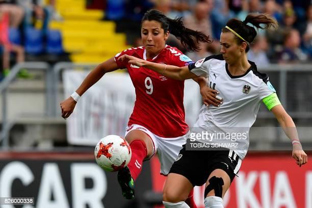 Denmark's forward Nadia Nadim vies for the ball with Austria's defender Viktoria Schnaderbeck during the UEFA Womens Euro 2017 football tournament...