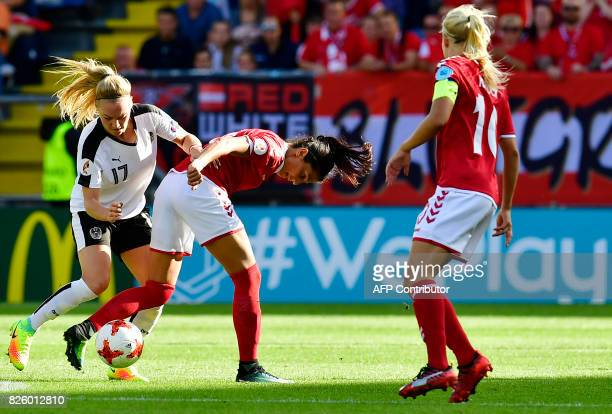 Denmark's forward Nadia Nadim vies for the ball with Austria's midfielder Sarah Puntigam during the UEFA Womens Euro 2017 football tournament...