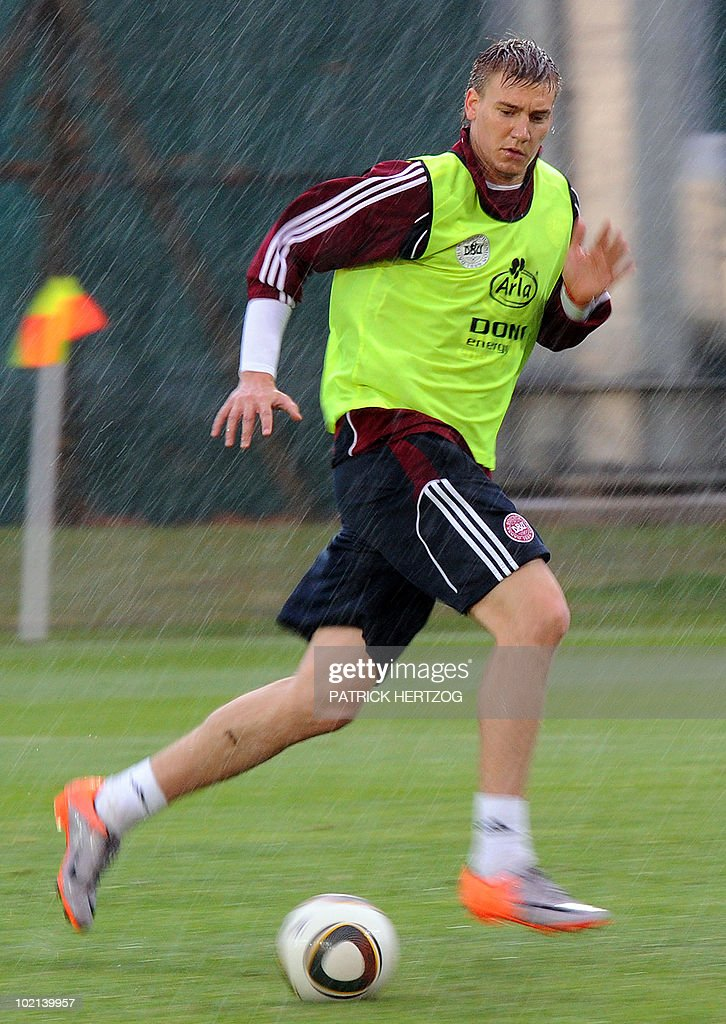 Denmark's forward Nicklas Bendtner controls the ball during a training session under the rain at Loerie Park in Knysna on June 16, 2010 during the 2010 World Cup tournament in South Africa.
