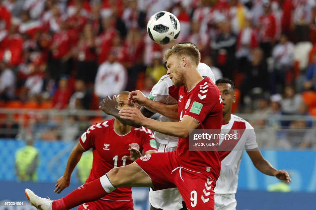 TOPSHOT - Denmark's forward Nicolai Jorgensen (front C) heads the ball during the Russia 2018 World Cup Group C football match between Peru and Denmark at the Mordovia Arena in Saransk on June 16, 2018. (Photo by Jack GUEZ / AFP) / RESTRICTED