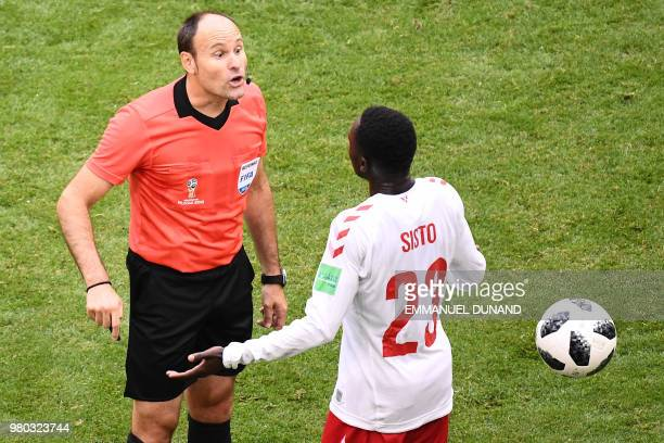 TOPSHOT Denmark's forward Pione Sisto speaks to Spanish referee Antonio Mateu Lahoz during the Russia 2018 World Cup Group C football match between...