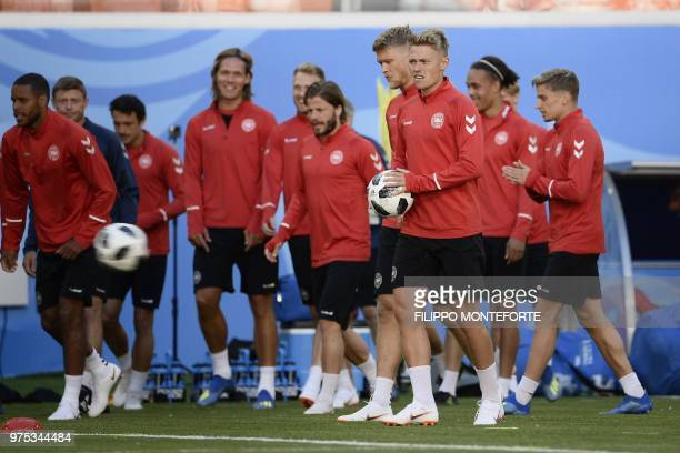 Denmark's forward Viktor Fischer holds the ball as he takes part in a training session of Denmark's national football team at the Mordovia Arena in...