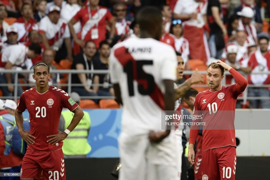 Denmark's forward Yussuf Poulsen (L) and Denmark's midfielder Christian Eriksen (R) react during the Russia 2018 World Cup Group C football match between Peru and Denmark at the Mordovia Arena in Saransk on June 16, 2018. (Photo by Filippo MONTEFORTE / AFP) / RESTRICTED