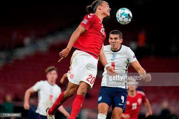 Denmark's forward Yussuf Poulsen and England's defender Conor Coady vie for the ball during the UEFA Nations League football match between Denmark...