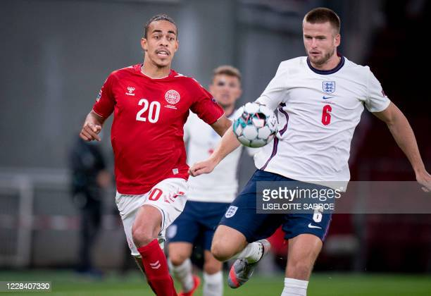 Denmark's forward Yussuf Poulsen and England's midfielder Eric Dier vie for the ball during the UEFA Nations League football match between Denmark...