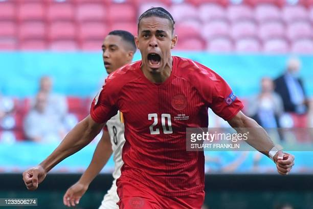 Denmark's forward Yussuf Poulsen celebrates after scoring the team's first goal during the UEFA EURO 2020 Group B football match between Denmark and...