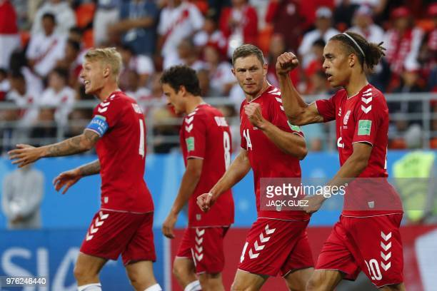 TOPSHOT Denmark's forward Yussuf Poulsen celebrates with teammates after scoring a goal during the Russia 2018 World Cup Group C football match...
