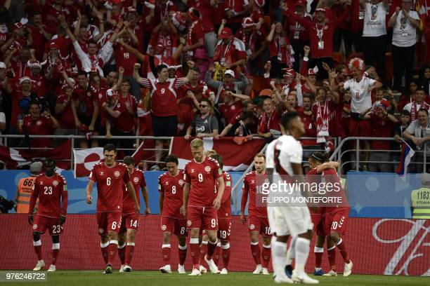 Denmark's forward Yussuf Poulsen celebrates with teammates after scoring a goal during the Russia 2018 World Cup Group C football match between Peru...
