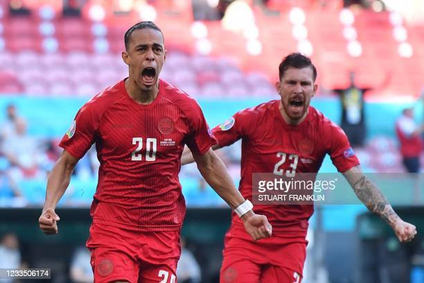 Denmark's forward Yussuf Poulsen celebrates with teammates after scoring the team's first goal during the UEFA EURO 2020 Group B football match...