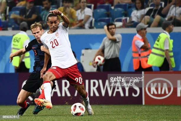 Denmark's forward Yussuf Poulsen challenges Croatia's defender Ivan Strinic during the Russia 2018 World Cup round of 16 football match between...
