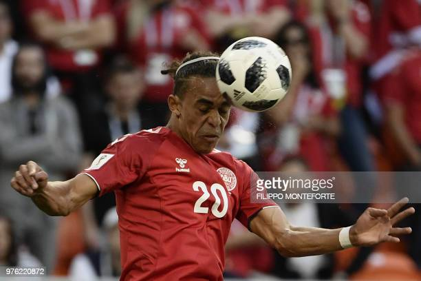 TOPSHOT Denmark's forward Yussuf Poulsen heads the ball during the Russia 2018 World Cup Group C football match between Peru and Denmark at the...