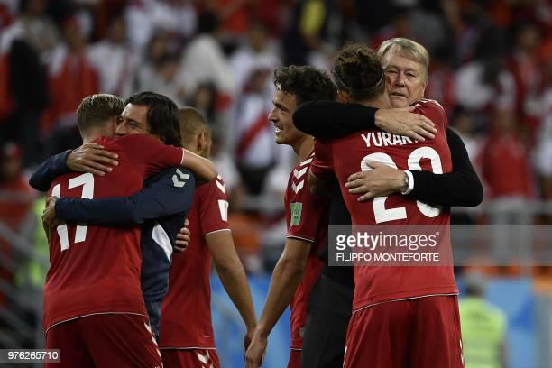 TOPSHOT Denmark's forward Yussuf Poulsen is is congratulated by Denmark's coach Age Hareide at the end of the Russia 2018 World Cup Group C football...