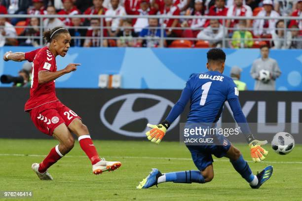 Denmark's forward Yussuf Poulsen scores a goal past Peru's goalkeeper Pedro Gallese during the Russia 2018 World Cup Group C football match between...