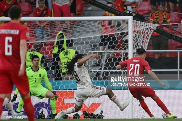 Denmark's forward Yussuf Poulsen shoots to score the opening goal during the UEFA EURO 2020 Group B football match between Denmark and Belgium at the...