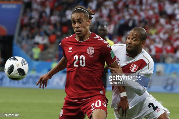Denmark's forward Yussuf Poulsen vies for the ball with Peru's defender Alberto Rodriguez during the Russia 2018 World Cup Group C football match...